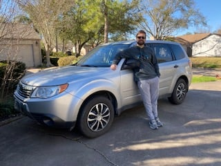 man helped by credit union auto loan